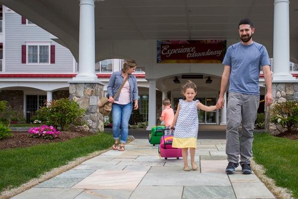 family leaving the resort