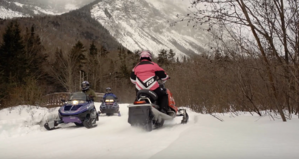 couples snowmobiling tour